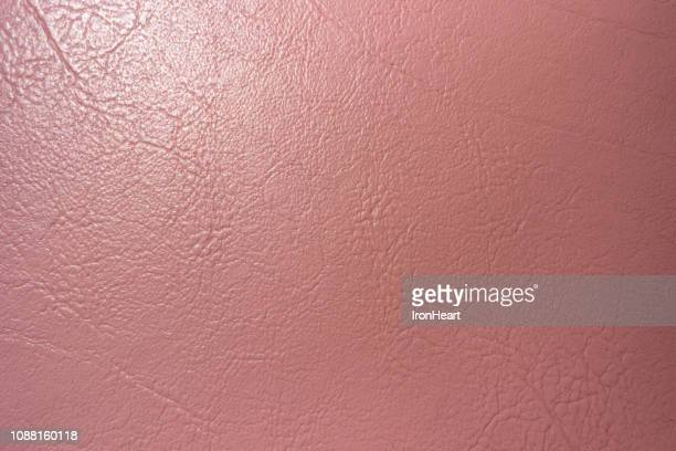 Rugged surface of pink genuine leather abstract background vintage.