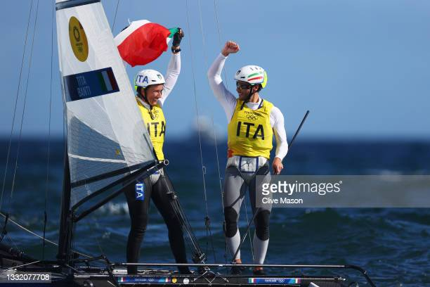Ruggero Tita and Caterina Banti of Team Italy celebrate winning the Nacra 17 Foiling class on day eleven of the Tokyo 2020 Olympic Games at Enoshima...