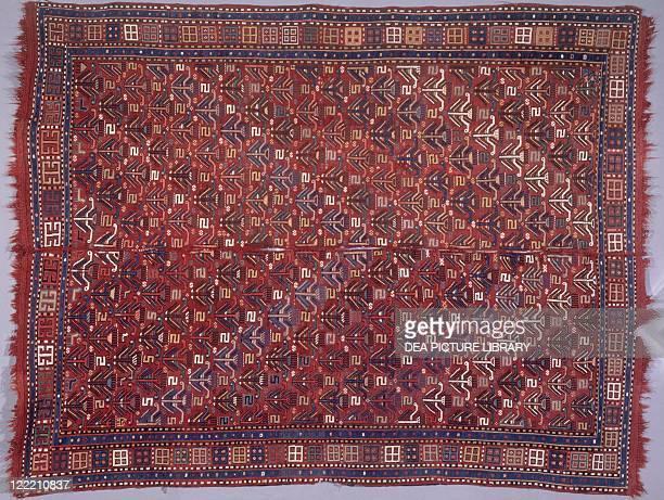 Rugs and Carpets Azerbaijan 20th century Woollen Kilim carpet with tulip motifs