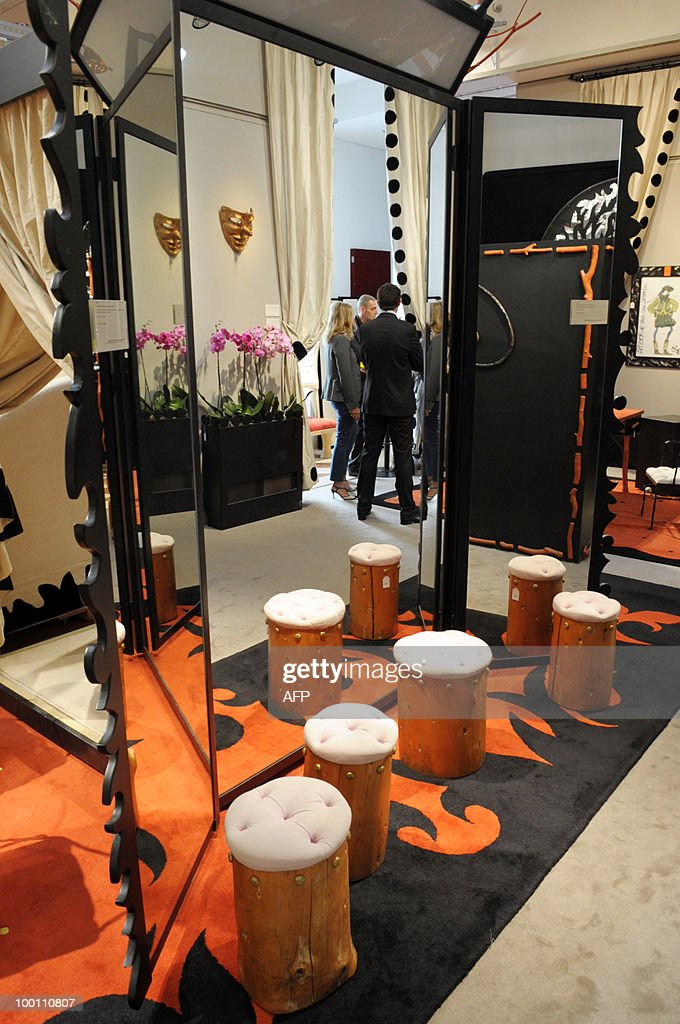 rug,stools, mirror designed by Elizabeth Garouste and Mattia Bonetti for French fashion house Christian Lacroix are among about 100 lots exhibited at the auction house Sotheby's France in Paris on May 21, 2010 before a sale on May 26, 2010 organised at the initiative of Christian Lacroix Company. In 1987 Christian Lacroix hired furniture designers Garouste and Bonetti to create the complete bespoke interior of his fashion house located on the Parisian Faubourg Saint Honore. Apart from the salons, the team also designed the packaging, the writing paper, the logo.