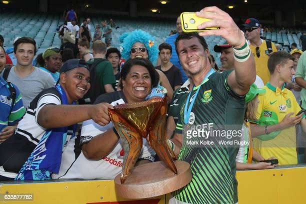 Ruhan Nel of South Africa poses for a selfie with the crowd as he celebrates winning the Cup Final match between England and South Africa in the 2017...