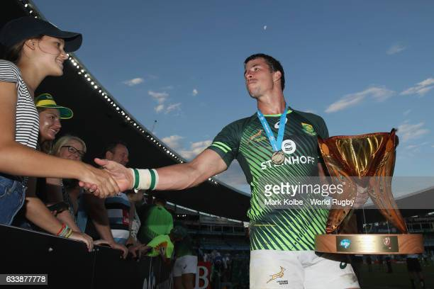 Ruhan Nel of South Africa shakes hands with the crowd as he celebrates winning the Cup Final match between England and South Africa in the 2017 HSBC...