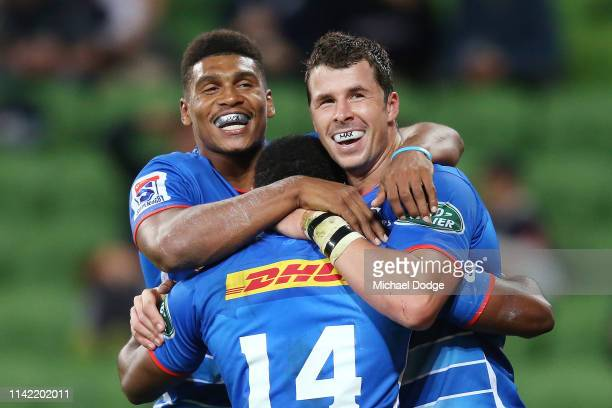 Ruhan Nel of the Stormers celebrates a try with Damian Willemse of the Stormers during the round nine Super Rugby match between the Rebels and the...