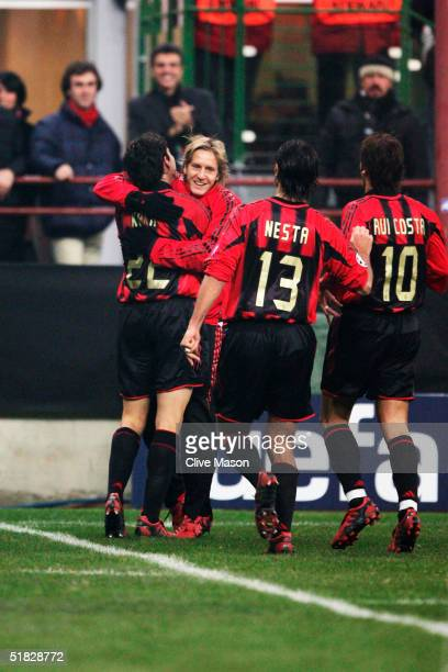 Rui Costa Alessandro Nesta Kaka and Andriy Shevchenko of AC Milan celebrate during the UEFA Champions League Group F match between AC Milan and...