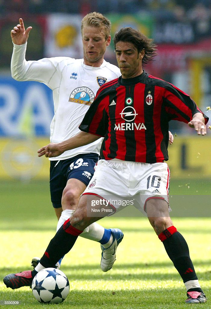 Rui Costa and Grella in action during the Serie A match between Milan and Empoli April 10, 2004 in Milan, Italy.