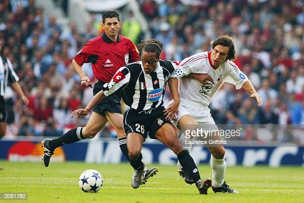 Rui Costa of AC Milan challenges Edgar Davids of Juventus during the UEFA Champions League Final match between Juventus FC and AC Milan on May 28...