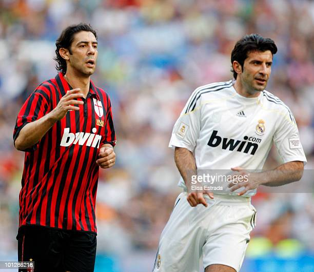Rui Costa of Milan and Luis Figo of Real Madrid in action during the Corazon Classic Match between Real Madrid and Milan on May 30 2010 in Madrid...