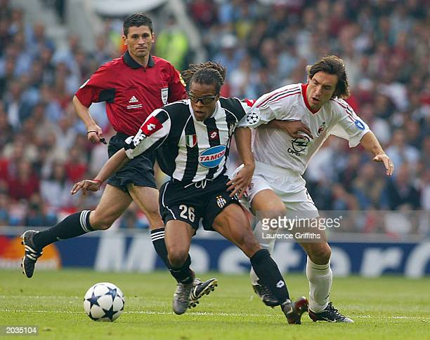 Rui Costa of Milan attempts to tackle Edgar Davids of Juventus FC during the UEFA Champions League Final match between Juventus FC and AC Milan on...