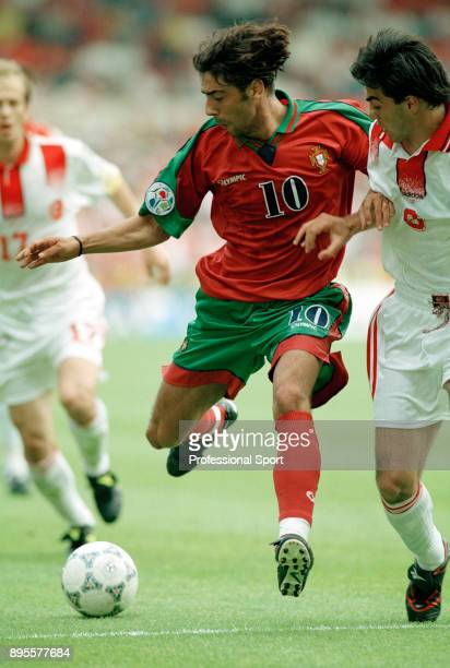 Rui Costa of Portugal and Ogün Temizkanolu of Turkey battle for the ball during a UEFA Euro 96 group match at the City Ground on June 14 1996 in...