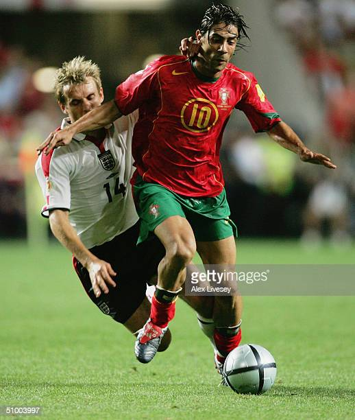 Rui Costa of Portugal and Phil Neville of England during the UEFA Euro 2004 Quarter Final match between Portugal and England at the Luz Stadium on...