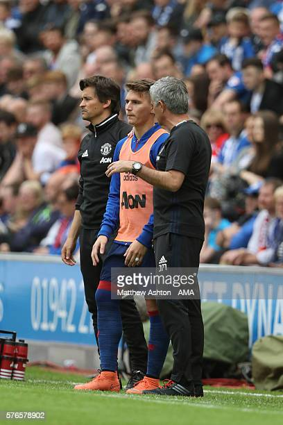 Rui Faria the Manchester United assistant manager and manager Jose Mourinho give Guillermo Varela instructions before coming on as a second half...