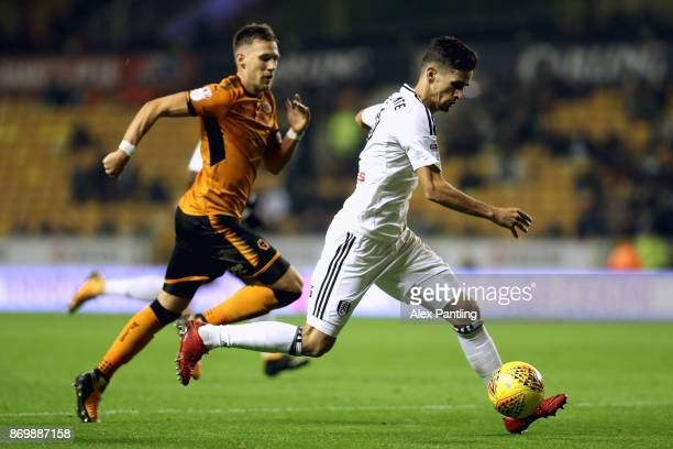 Rui Fonte of Fulham and Barry Douglas of Wolverhampton Wanderers in action during the Sky Bet Championship match between Wolverhampton Wanderers and...