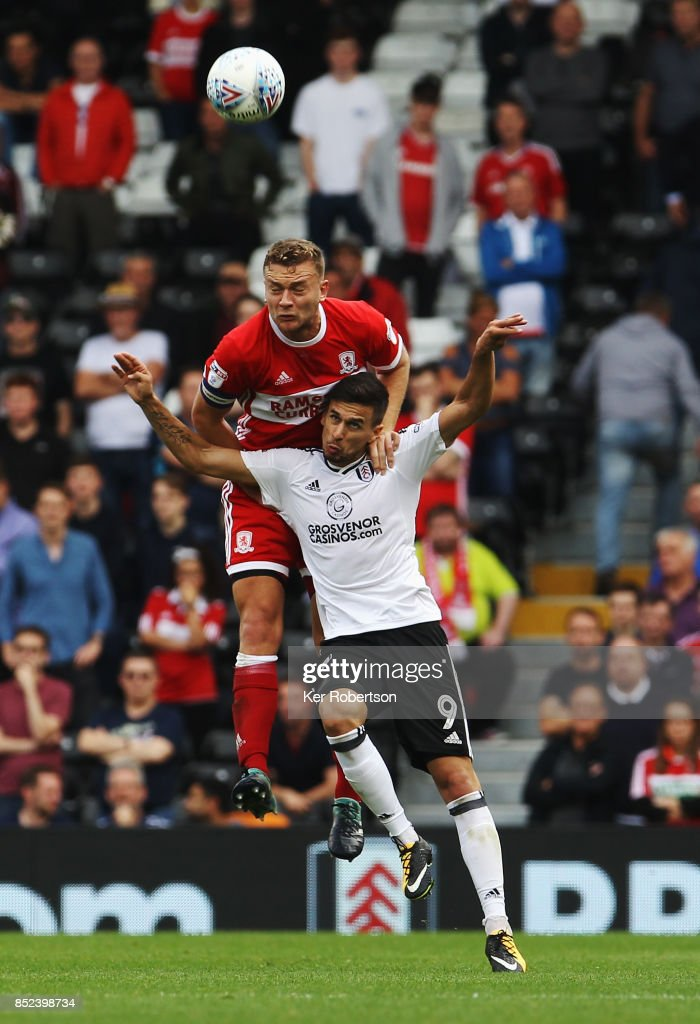 Rui Fonte (front) of Fulham and Ben Gibson (rear) of Middlesbrough challenge for the ball during the Sky Bet Championship match between Fulham and Middlesbrough at Craven Cottage on September 23, 2017 in London, England.