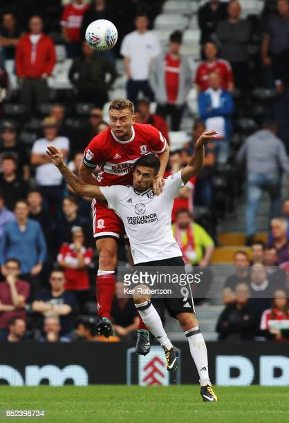 Rui Fonte of Fulham and Ben Gibson of Middlesbrough challenge for the ball during the Sky Bet Championship match between Fulham and Middlesbrough at...