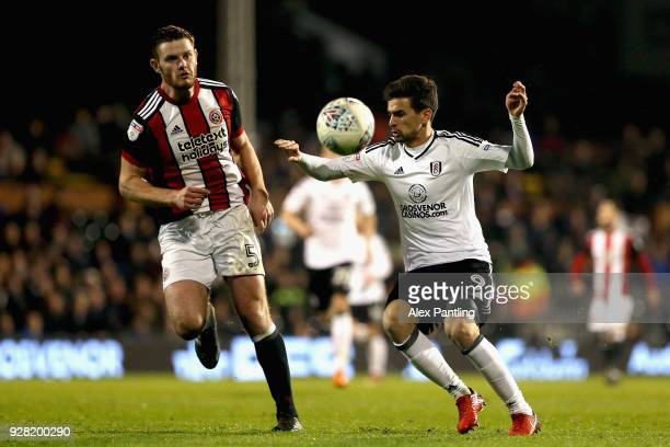Rui Fonte of Fulham and Jack O'Connell of Sheffield United clash during the Sky Bet Championship match between Fulham and Sheffield United at Craven...