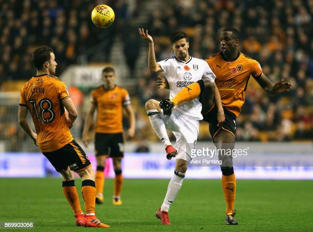 Rui Fonte of Fulham and Willy Boly of Wolverhampton Wanderers in action during the Sky Bet Championship match between Wolverhampton Wanderers and...