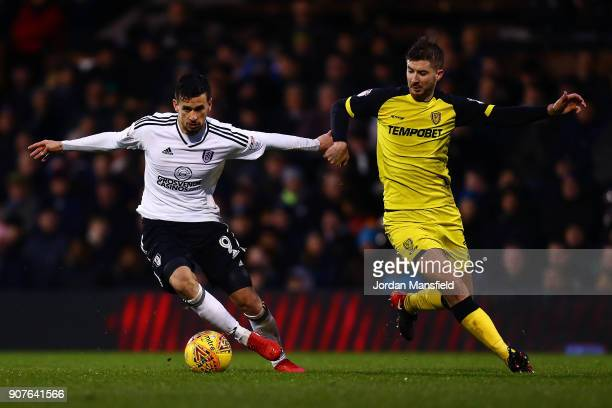 Rui Fonte of Fulham holds off a challenge from Luke Murphy of Burton during the Sky Bet Championship match between Fulham and Burton Albion at Craven...