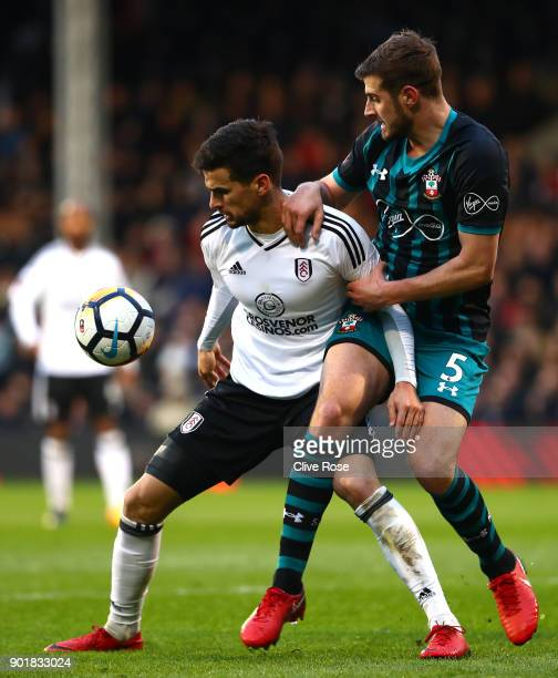 Rui Fonte of Fulham holds off Jack Stephens of Southampton during the The Emirates FA Cup Third Round match between Fulham and Southampton at Craven...