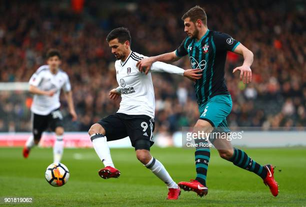 Rui Fonte of Fulham is challenged by Jack Stephens of Southampton during the The Emirates FA Cup Third Round match between Fulham and Southampton at...