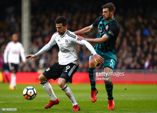 Rui Fonte of Fulham is challenged by Jack Stephens of Southampton during The Emirates FA Cup Third Round match between Fulham and Southampton at...