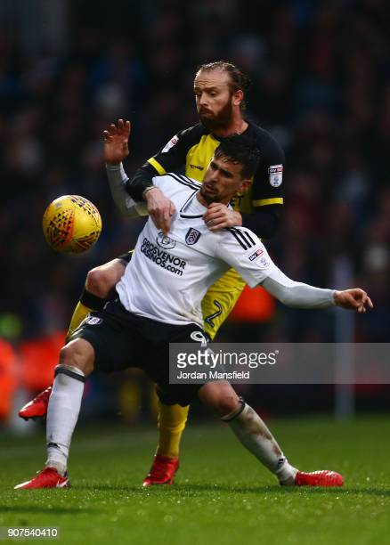 Rui Fonte of Fulham is tackled by John Brayford of Burton during the Sky Bet Championship match between Fulham and Burton Albion at Craven Cottage on...