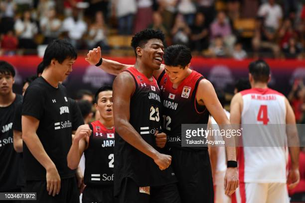 Rui Hachimura and Yuta Watanabe of Japan celebrate after defeating Iran 7056 in the FIBA Men's World Cup Asian Qualifier 2nd Round Group F match...