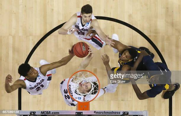 Rui Hachimura and Zach Collins of the Gonzaga Bulldogs go up for the rebound against the West Virginia Mountaineers during the 2017 NCAA Men's...
