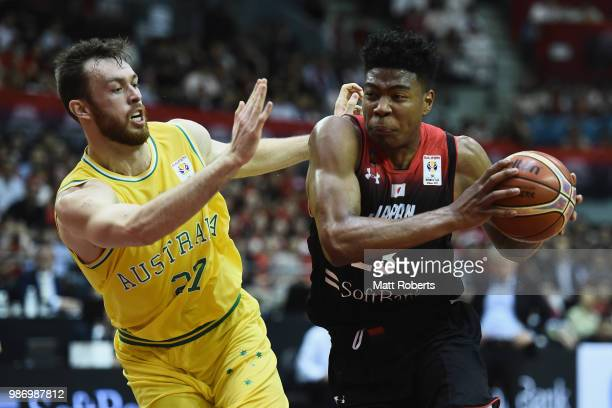 Rui Hachimura of Japan takes on the defence of Nicholas Kay of Australia during the FIBA World Cup Asian Qualifier Group B match between Japan and...