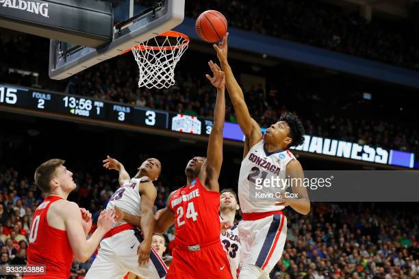 Rui Hachimura of the Gonzaga Bulldogs and Andre Wesson of the Ohio State Buckeyes battle for a rebound during the first half in the second round of...