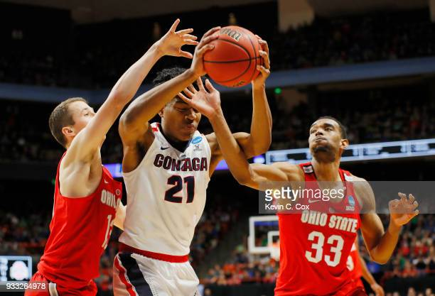 Rui Hachimura of the Gonzaga Bulldogs battles for the ball with Andrew Dakich and Keita BatesDiop of the Ohio State Buckeyes during the second half...