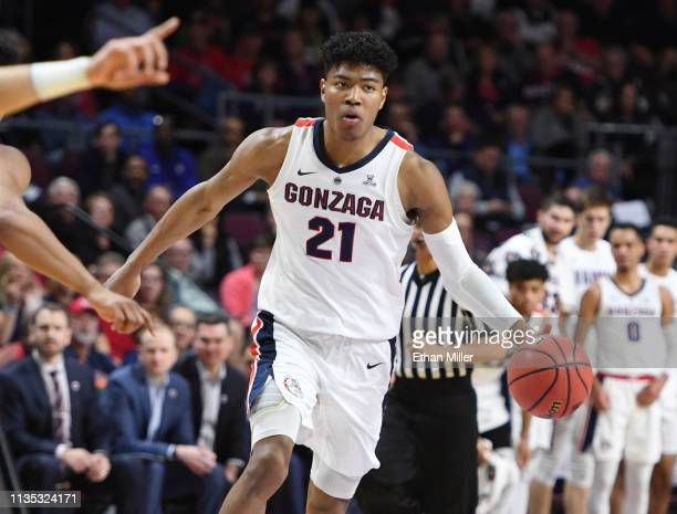 Rui Hachimura of the Gonzaga Bulldogs brings the ball up the court against the Pepperdine Waves during a semifinal game of the West Coast Conference...