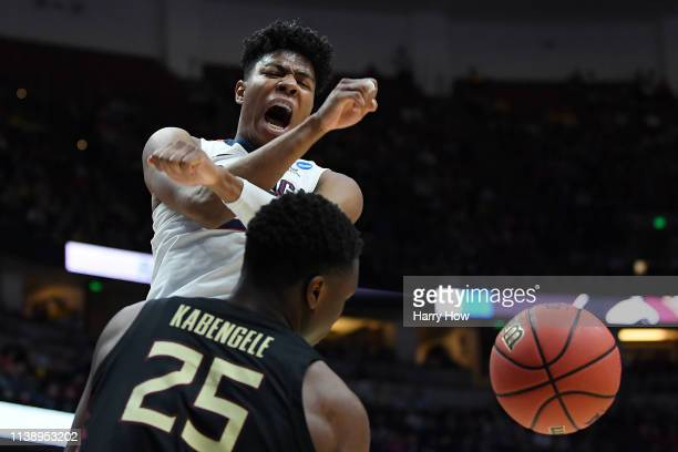 Rui Hachimura of the Gonzaga Bulldogs celebrates after a dunk against Mfiondu Kabengele of the Florida State Seminoles during the 2019 NCAA Men's...