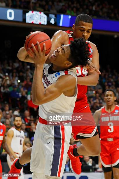 Rui Hachimura of the Gonzaga Bulldogs collides with Kaleb Wesson of the Ohio State Buckeyes during the first half in the second round of the 2018...