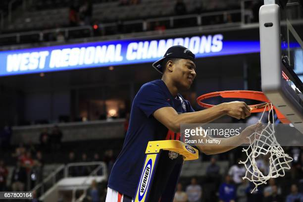 Rui Hachimura of the Gonzaga Bulldogs cuts down the net after their 83 to 59 win over the Xavier Musketeers during the 2017 NCAA Men's Basketball...