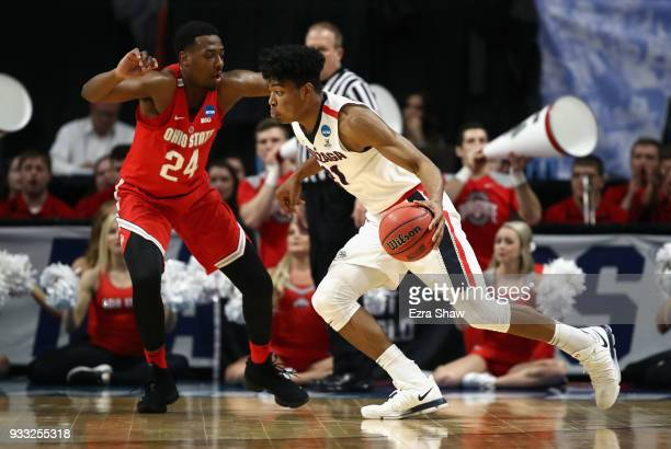 Rui Hachimura of the Gonzaga Bulldogs dribbles against Andre Wesson of the Ohio State Buckeyes during the first half in the second round of the 2018...