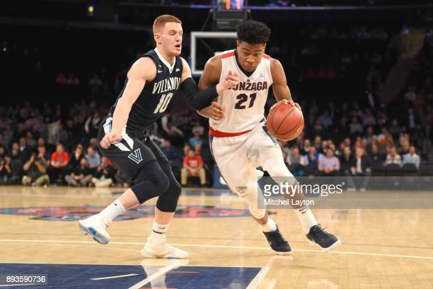 Rui Hachimura of the Gonzaga Bulldogs dribbles the ball by Donte DiVincenzo of the Villanova Wildcats during the Jimmy V Classic college basketball...