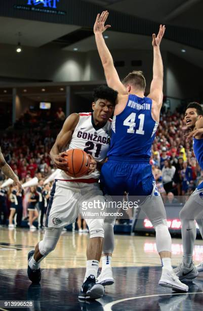 Rui Hachimura of the Gonzaga Bulldogs drives against Luke Worthington of the BYU Cougars in the second half at McCarthey Athletic Center on February...