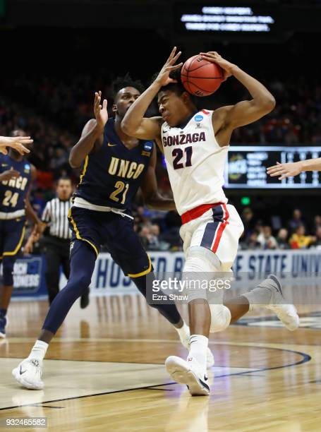 Rui Hachimura of the Gonzaga Bulldogs drives to the basket against James Dickey of the UNC-Greensboro Spartans in the first half during the first...
