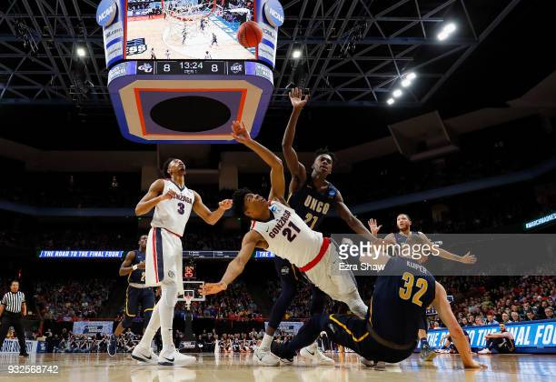 Rui Hachimura of the Gonzaga Bulldogs falls as he shoots the ball against the UNCGreensboro Spartans during the first round of the 2018 NCAA Men's...