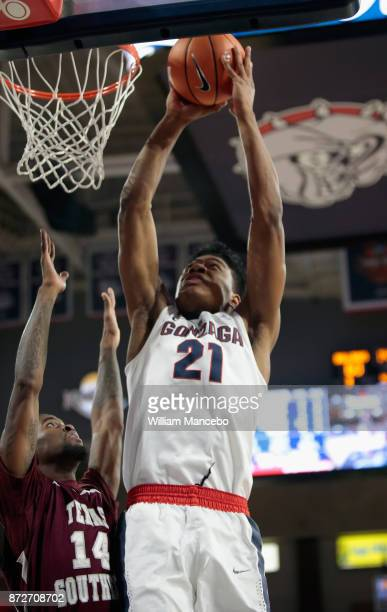 Rui Hachimura of the Gonzaga Bulldogs goes to the basket against Lamont Walker of the Texas Southern Tigers in the second half at McCarthey Athletic...