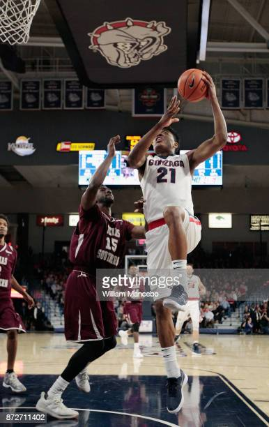 Rui Hachimura of the Gonzaga Bulldogs goes to the basket against Marquis Salmon of the Texas Southern Tigers in the second half at McCarthey Athletic...