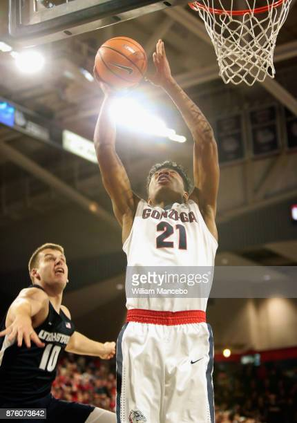 Rui Hachimura of the Gonzaga Bulldogs goes to the basket against Quinn Taylor of the Utah State Aggies in the first half at McCarthey Athletic Center...
