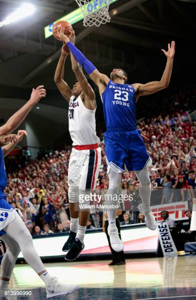 Rui Hachimura of the Gonzaga Bulldogs goes to the basket against Yoeli Childs of the BYU Cougars in the second half at McCarthey Athletic Center on...