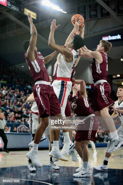 Rui Hachimura of the Gonzaga Bulldogs goes up for an offensive rebound against Shaquille Walters Kai Healy and Henry Caruso of the Santa Clara...