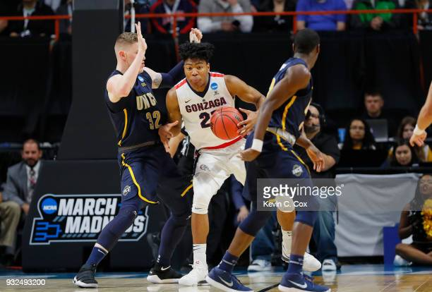 Rui Hachimura of the Gonzaga Bulldogs handles the ball against Jordy Kuiper of the UNCGreensboro Spartans in the first half during the first round of...