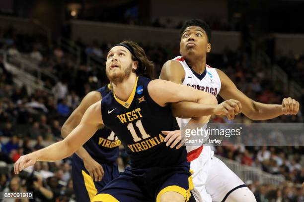 Rui Hachimura of the Gonzaga Bulldogs is boxed out by Nathan Adrian of the West Virginia Mountaineers during the 2017 NCAA Men's Basketball...