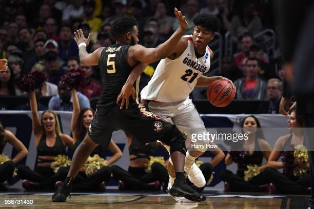 Rui Hachimura of the Gonzaga Bulldogs is defended by PJ Savoy of the Florida State Seminoles during the first half in the 2018 NCAA Men's Basketball...