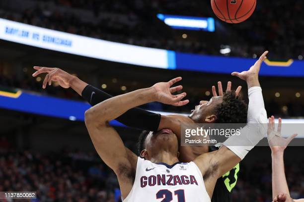 Rui Hachimura of the Gonzaga Bulldogs is hit by Freddie Gillespie of the Baylor Bears during their game in the Second Round of the NCAA Basketball...