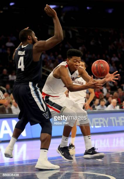 Rui Hachimura of the Gonzaga Bulldogs loses the ball in the first half against Eric Paschall of the Villanova Wildcats during their game at Madison...