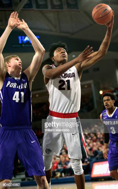 Rui Hachimura of the Gonzaga Bulldogs puts up a shot against Joseph Smoyer of the Portland Pilots in the second half at McCarthey Athletic Center on...